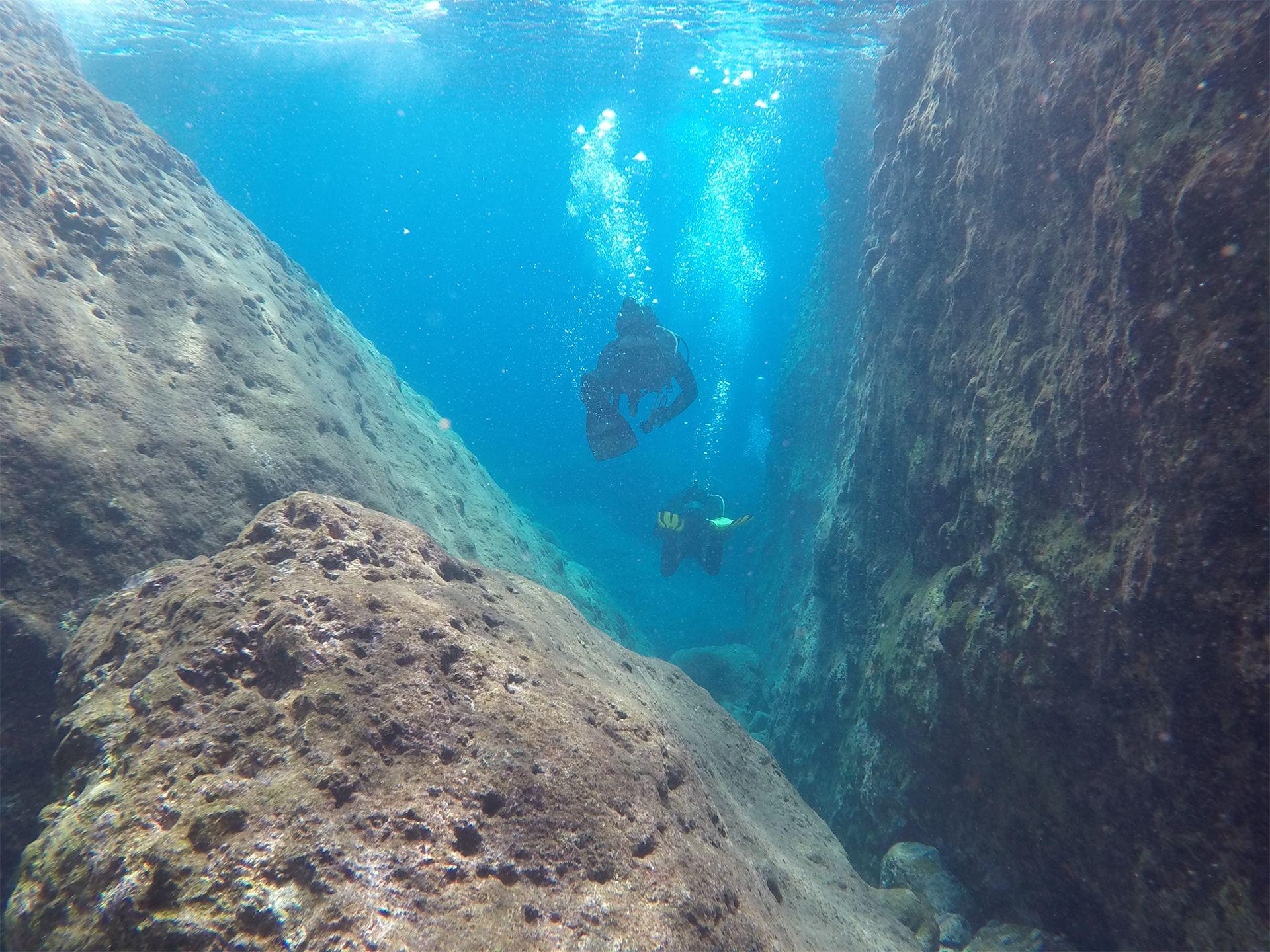 Couple diving in Santorini Greece